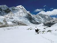 Trekking the snowy fields back towards Ghunsa on the Great Himalaya Trail, Nepal.