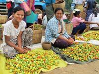 Local women at a market in Myanmar.