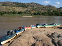 Canoes lined up along Manambolo River -  Photo: Janet Oldham