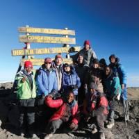 Trekkers and guide group on Kilimanjaro Uhuru Summit | Kyle Super
