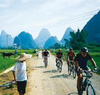 Cycling through rural villages Yangshuo, China -  Photo: Scott Pinnegar