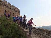 Group shot of trekkers exiting one of the many guard towers along the Great Wall |  <i>Victoria Earl</i>