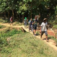 A family following our local hiking guide in Laos | Kate Harper