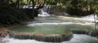 Serene pools at  Khuang Si Waterfall | Kylie Turner