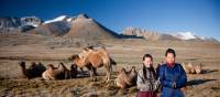 Local herders with their camels on the Mongolian steppe | Cam Cope