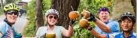 Cyclists enjoying a refreshing coconut roadside in Vietnam |  <i>Lachlan Gardiner</i>