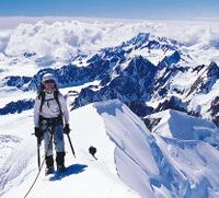 Climber on the summit of Aoraki Mt Cook, New Zealand