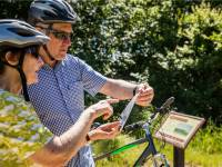 Planning the days' cycling on the Otago Central Rail Trail |  <i>Lachlan Gardiner</i>