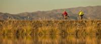 Clients riding along side the beautiful Tekapo canal system on one of our New Zealand cycle journeys   Colin Monteath