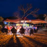 Relaxing around an open fire after a day on the Larapinta Trail | Caroline Crick
