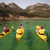 Kayaking the crystal clear waters of the Freycinet Peninsula on Cycle, Kayak and Walk Tasmania