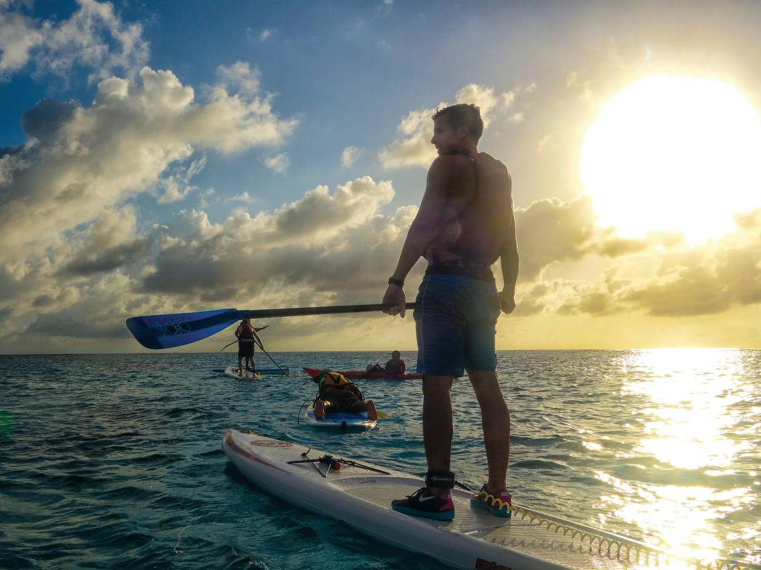 Stand up paddle boarding in the warm waters of Lighthouse Reef