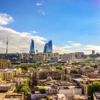 Baku, the cosmopolitan capital of Azerbaijan, where ancient Zoroastrian fire temples meet modern glass sky scrapers.