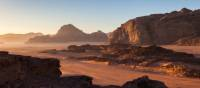 Wadi Rum's desert landscape at sunrise | Richard I'Anson