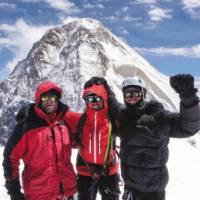 On Chapayev Peak with Khan Tengri in the background | Warren Townsden
