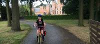 Young cyclist outside a castle near Ghent | Hilary Delbridge