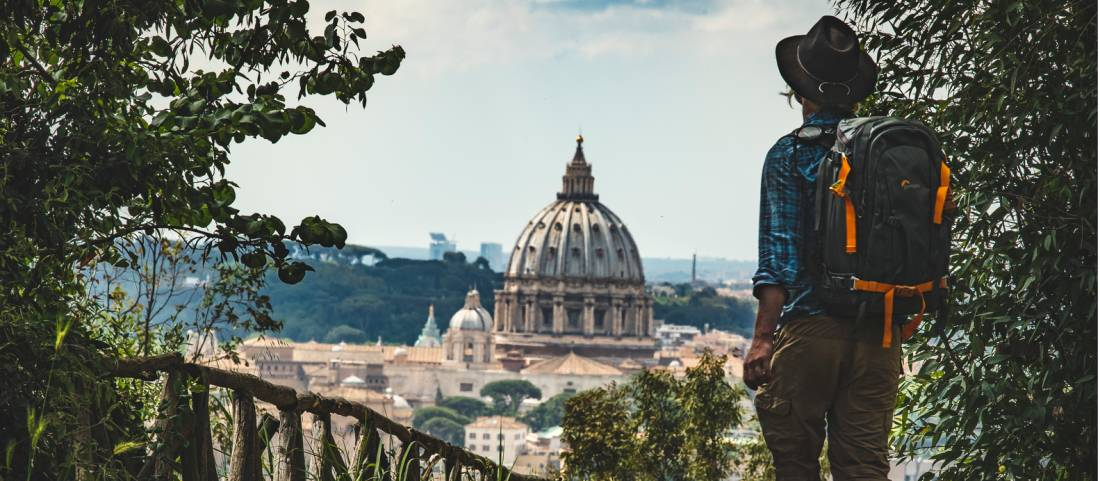 Pilgrim walking into St Peters in Rome at the end of the Via Francigena |  <i>Tim Charody</i>