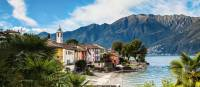 Colourful houses line Lake Maggiore in the Ticino Canton of Switzerland   Jan Geerk