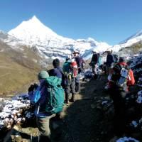 Trekkers stopping to admire the views towards Jichu Drake | Gavin Turner
