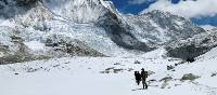 Trekking through snow on the way towards Ghunsa | Ray Mustey