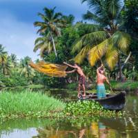 Villagers fishing in the backwaters near Kerala | Richard I'Anson