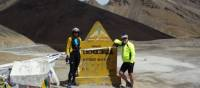 Taking a breather on the summit of Lachulung during the Leh to Manali Cycle | Geoff Gabites