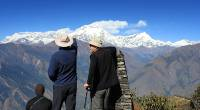 Trekkers admiring Dhaulagiri as seen from the view point above the Kali Gandaki Gorge |  <i>Brad Atwal</i>