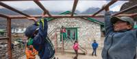 Local children playing on the monkey bars at Khumjung school | Mark Tipple