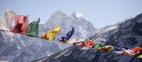 Prayer flags blowing in the Everest breeze | Charles Duncombe