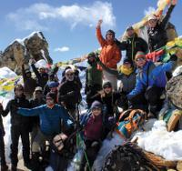 Happy group of trekkers atop of the Renjo La, Nepal -  Photo: Scott Cardwell