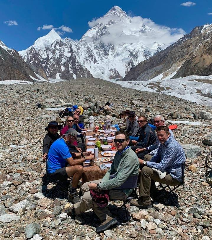 Trekkers dining with a mountainous backdrop |  <i>Soren Kruse Ledet</i>