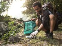 Traveller collecting litter along wilderness trails, part of our 10 Pieces litter collection program -  Photo: Mark Tipple