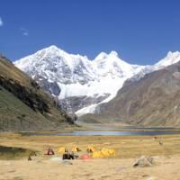 Camping amongst the rugged snowcapped peaks of Huayhuash, Peru   Ken Harris