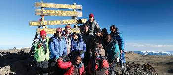 Trekkers and guide group on Kilimanjaro Uhuru Summit | Kyle Super