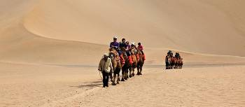 Camel riding at Mingsha Dunes in western China | Peter Walton