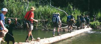 Trekkers crossing the Brown River on Day 5 of the Kokoda Trail | Rachael Davis