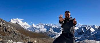 A happy trekker on the Karakachu La (5020m) pass in Bhutan | Matt Brazier
