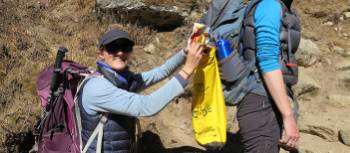 Picking up rubbish for the 10 Pieces Initiative on Everest Circuit & the Cho La | Ayla Rowe
