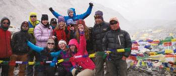 Trekkers posing for the camera at Everest base camp | Sally Imber